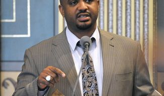 Michigan State Sen. Bert Johnson, D-Highland Park, is seen in a May 14, 2015 photo. Michigan State Police say Monday, March 27, 2017, that the office and home of Sen. Johnson are being searched as part of a joint investigation involving the FBI. Details of what investigators were seeking weren't immediately released.   (Dale G. Young/The Detroit News via AP)