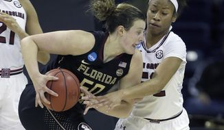 South Carolina guard Tyasha Harris, right, tries to steal the ball from Florida State Seminoles Chatrice White during the first half of a regional final game of the women's NCAA college basketball tournament, Monday, March 27, 2017, in Stockton, Calif. (AP Photo/Rich Pedroncelli)