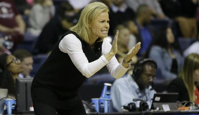 Florida State head coach Sue Semrau claps after her team scored against South Carolina during the first half of a regional final game of the women's NCAA college basketball tournament, Monday, March 27, 2017, in Stockton, Calif. (AP Photo/Rich Pedroncelli)
