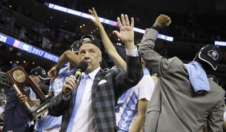 North Carolina head coach Roy Williams thanks the fans after North Carolina beat Kentucky 75-73 in the South Regional final game in the NCAA college basketball tournament Sunday, March 26, 2017, in Memphis, Tenn. (AP Photo/Mark Humphrey)