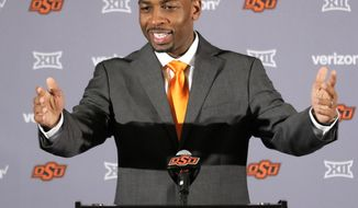 Oklahoma State's new head basketball coach Mike Boynton talks to members of the media during a news conference at Oklahoma State University in Stillwater, Okla., Monday, March 27, 2017. (Steve Gooch/The Oklahoman via AP)