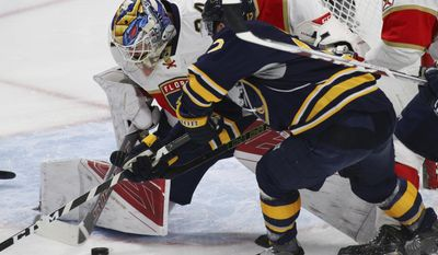 Buffalo Sabres forward Brian Gionta (12) is stopped by Florida Panthers goalie James Reimer (34) during the first period of an NHL hockey game, Monday, March 27, 2017, in Buffalo, N.Y. (AP Photo/Jeffrey T. Barnes)