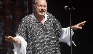 "FILE - In this June 30, 2013, file photo, John Lydon performs with his band PiL at the Glastonbury Music Festival at Glastonbury, England. Lydon, whose also known by his stage name, Johnny Rotten, told ITV's ""Good Morning Britain"" on March 27, 2017, that he supports U.S. President Donald Trump. (Photo by Jim Ross/Invision/AP, File)"