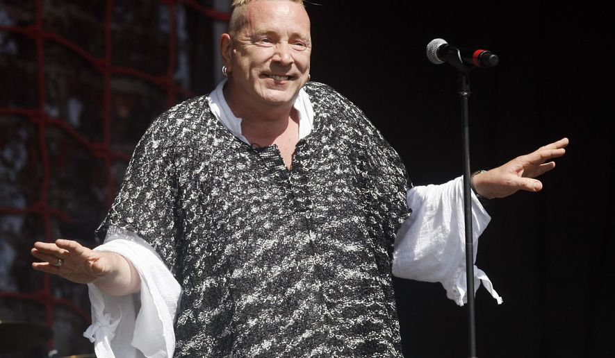 """FILE - In this June 30, 2013, file photo, John Lydon performs with his band PiL at the Glastonbury Music Festival at Glastonbury, England. Lydon, whose also known by his stage name, Johnny Rotten, told ITV's """"Good Morning Britain"""" on March 27, 2017, that he supports U.S. President Donald Trump. (Photo by Jim Ross/Invision/AP, File)"""