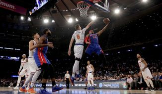 Detroit Pistons forward Tobias Harris (34) goes up for a shot against New York Knicks forward Kristaps Porzingis (6) during the first quarter of an NBA basketball game, Monday, March 27, 2017, in New York. (AP Photo/Julie Jacobson)