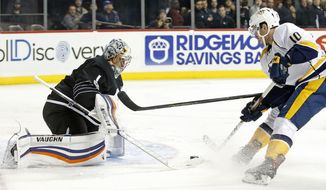 Nashville Predators center Colton Sissons (10) threatens to score in front of New York Islanders goalie Thomas Greiss (1), of Germany, in the first period of an NHL hockey game in New York, Monday, March 27, 2017. (AP Photo/Kathy Willens)