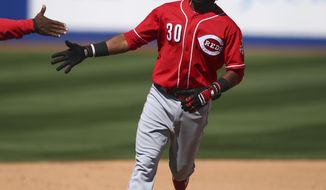 Cincinnati Reds' Arismendy Alcantara (30) rounds third base after hitting a home run against the Chicago Cubs during a baseball game in Las Vegas, Saturday, March 25, 2017. (Chase Stevens/Las Vegas Review-Journal via AP)