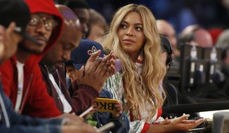 FILE - In this  Feb. 19, 2017. file photo, Beyonce sits at court side during the second half of the NBA All-Star basketball game in New Orleans. A Houston high school student lost her battle with cancer on March 25, 2017, days after receiving a FaceTime call from the singer. (AP Photo/Max Becherer, File)