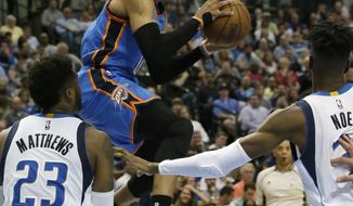 Oklahoma City Thunder guard Russell Westbrook (0) looks to pass against Dallas Mavericks guard Wesley Matthews (23) and forward Nerlens Noel (3) during the first half of an NBA basketball game in Dallas, Monday, March 27, 2017. (AP Photo/LM Otero)