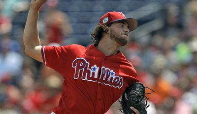 Philadelphia Phillies' Aaron Nola pitches to the Minnesota Twins during the first inning of a spring training baseball game Thursday, March 23, 2017, in Clearwater, Fla. (AP Photo/Chris O'Meara)