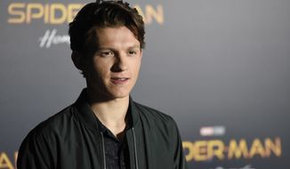 "Tom Holland, a cast member in the upcoming film ""Spider-man: Homecoming,"" poses during a photo call backstage of the Sony Pictures Entertainment presentation at CinemaCon 2017 at Caesars Palace on Monday, March 27, 2017, in Las Vegas. (Photo by Chris Pizzello/Invision/AP)"