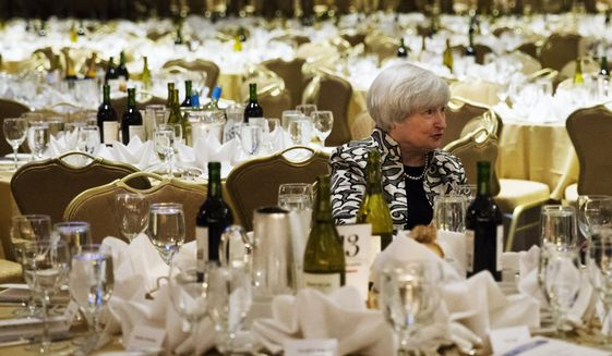 Federal Reserve Chairwoman Janet Yellen sits at a table before the start of the White House Correspondents' Association (WHCA) Dinner at the Washington Hilton Hotel, Saturday, May 3, 2014, in Washington. (AP Photo/Jacquelyn Martin)