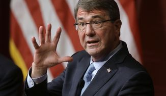 In this Dec. 1, 2015, file photo, then-Defense Secretary Ash Carter responds to a question during a forum at the John F. Kennedy School of Government at Harvard University in Cambridge, Mass. (AP Photo/Steven Senne, File)