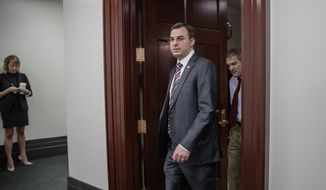 Rep. Justin Amash, R-Mich., followed by Rep. Jim Jordan, R-Ohio, both members of the House Freedom Caucus whose conservative GOP members derailed the Republican health care bill last week, leave a closed-door strategy session with Speaker of the House Paul D. Ryan, R-Wis., and the leadership as they try to rebuild unity within the Republican Conference, at the Capitol, in Washington, in this Tuesday, March 28, 2017, file photo. (AP Photo/J. Scott Applewhite) ** FILE **