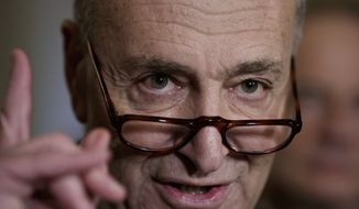 Senate Minority Leader Charles Schumer of N.Y. speaks with reporters following a closed-door strategy session, Tuesday, March 28, 2017, on Capitol Hill in Washington. (AP Photo/J. Scott Applewhite)