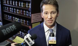 FILE - In this Feb. 6, 2015, file photo, former Rep. Aaron Schock, R-Ill. speaks to reporters in Peoria, Ill. Attorneys for former Schock say a staffer secretly provided the government with a trove of confidential documents in violation of his right against unreasonable search and seizure. The lawyers write in March 28, 2017, court filings that the government went too far when it made the staffer an informant, requiring him to wear a wire to record conversations.(AP Photo/Seth Perlman, File)