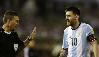 """In this photo taken Thursday March 23, 2017 Argentina's Lionel Messi argues assistant referee Emerson Augusto de Carvalho during a World Cup qualifying match against Chile in Buenos Aires, Argentina. Messi has been banned from Argentina's next four World Cup qualifiers, starting with Tuesday's game in Bolivia, for """"having directed insulting words at an assistant referee"""" during a home qualifier against Chile on Thursday, FIFA said hours before kickoff in La Paz.(AP Photo/Victor R. Caivano) **FILE**"""