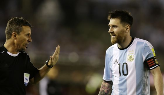 "In this photo taken Thursday March 23, 2017 Argentina's Lionel Messi argues assistant referee Emerson Augusto de Carvalho during a World Cup qualifying match against Chile in Buenos Aires, Argentina. Messi has been banned from Argentina's next four World Cup qualifiers, starting with Tuesday's game in Bolivia, for ""having directed insulting words at an assistant referee"" during a home qualifier against Chile on Thursday, FIFA said hours before kickoff in La Paz.(AP Photo/Victor R. Caivano) **FILE**"