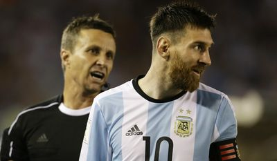 "In this photo taken Thursday March 23, 2017 assistant referee Emerson Augusto de Carvalho, left, talks to Argentina's Lionel Messi, right, during a World Cup qualifying match against Chile in Buenos Aires, Argentina. Messi has been banned from Argentina's next four World Cup qualifiers, starting with Tuesday's game in Bolivia, for ""having directed insulting words at an assistant referee"" during a home qualifier against Chile on Thursday, FIFA said hours before kickoff in La Paz.(AP Photo/Victor R. Caivano)"