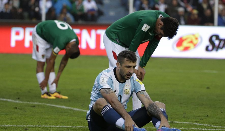 Argentina's Lucas Pratto sits on the pitch during a 2018 World Cup qualifying soccer soccer match against Bolivia in La Paz, Bolivia, on Tuesday, March 28, 2017. (AP Photo/Victor R. Caivano)