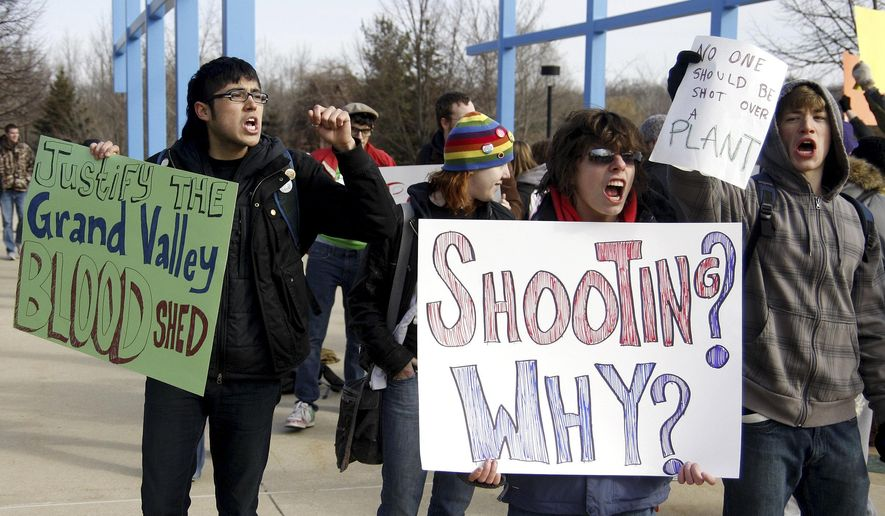 """FILE - In this March 13, 2009 file photo, students protest the shooting of an unarmed Grand Valley State University student in the """"Free Speech Zone"""" at Grand Valley State University in Allendale, Mich. Some colleges provide so-called """"free speech zones"""" as the only place where people can protest and distribute fliers. A student filed a federal lawsuit on Tuesday, March 28, 2017, against Los Angeles Pierce College, charging the community college violated his First Amendment rights in November 2016 when campus officials barred him from passing out copies of the U.S. Constitution because he wasn't in the free speech zone and because he hadn't applied to use it. (Hollyn Johnson/Grand Rapids Press via AP, File)"""