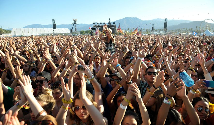 This 2013 file photo shows part of the crowd at the 2013 Coachella Valley Music and Arts Festival at the Empire Polo Club in Indio, Calif. (Photo by John Shearer/Invision/AP, File)