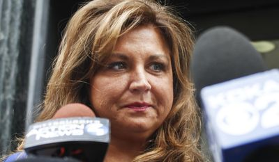 """FILE- In this June 27, 2016, file photo, """"Dance Moms"""" star Abby Lee Miller leaves federal court after pleading guilty in Pittsburgh to bankruptcy fraud and failing to report thousands of dollars in Australian currency she brought into the country. Miller posted on Instagram March 26, 2017, that she quit the Lifetime series. (AP Photo/Keith Srakocic, File)"""