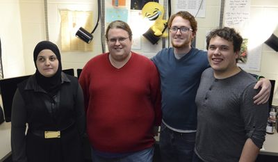 ADVANCE FOR SATURDAY, APRIL 1, 2017 - In this Tuesday, March 20, 2017 photo, Mona Minkara poses for a portrait in Kolthoff Hall with her team at the University of Minnesota, in Minneapolis. Minkara is the University's first blind, female, computational chemist. (Chris Dang /The Minnesota Daily via AP)