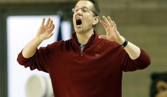 FILE- This March 17, 2017 file photo shows Belmont head coach Cameron Newbauer yelling to his team during a first-round game in the women's NCAA college basketball tournament against Kentucky in Lexington, Ky. Florida hired Newbauer on Monday, March 27, 2017 to revitalize its women's basketball program. (AP Photo/James Crisp)