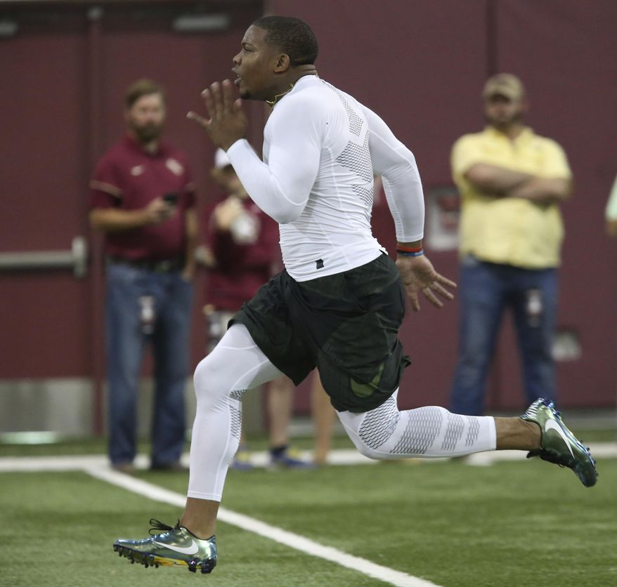 DeMarcus Walker runs the 40-yard dash for NFL scouts during Florida State's pro day, Tuesday, March 28, 2017 in Tallahassee, Fla. (AP Photo/Steve Cannon)