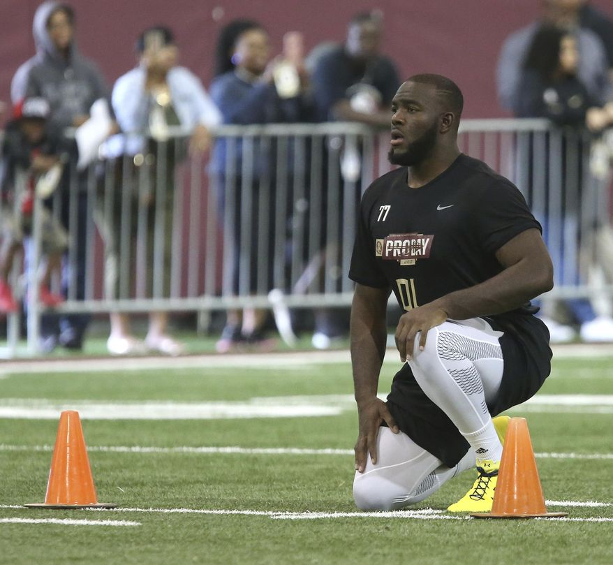 Roderick Johnson prepares himself to run the 40-yard dash for NFL scouts during Florida State's pro day, Tuesday, March 28, 2017 in Tallahassee, Fla. (AP Photo/Steve Cannon)