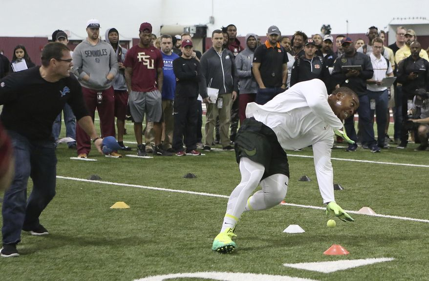 DeMarcus Walker runs a drill for NFL scouts during Florida State's pro day, Tuesday, March 28, 2017 in Tallahassee, Fla. (AP Photo/Steve Cannon)