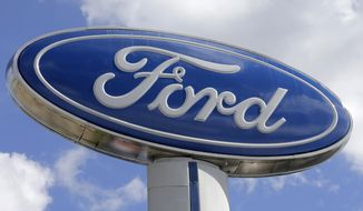 This Tuesday, Jan. 17, 2017, photo shows a Ford sign at an auto dealership in Hialeah, Fla. Ford Motor Co. is investing $1.2 billion in three Michigan facilities, including an engine plant where it plans to add 130 jobs. President Donald Trump applauded the move in an early morning tweet, Tuesday, March 28, 2017. (AP Photo/Alan Diaz)