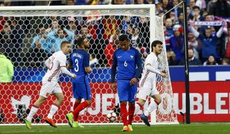 Spain's David Silva, right, celebrates scoring during the international friendly soccer match between France and Spain at the Stade de France, Paris, Tuesday, March 28, 2017. (AP Photo/Francois Mori)