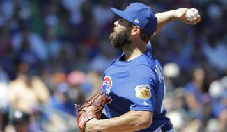 Chicago Cubs' Jake Arrieta throws during the first inning of a spring training baseball game against the San Francisco Giants, Tuesday, March 28, 2017, in Mesa, Ariz. (AP Photo/Darron Cummings)