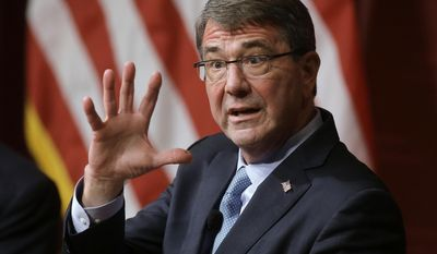 FILE - In this Dec. 1, 2015 file photo, Defense Secretary Ash Carter responds to a question during a forum at the John F. Kennedy School of Government at Harvard University in Cambridge, Mass. Harvard said Tuesday, March 28, 2017, that Carter is returning as a professor of technology and global affairs, and as director of Harvard's Belfer Center think tank. He previously taught at the Ivy League School from 1996 to 2009. (AP Photo/Steven Senne, File)