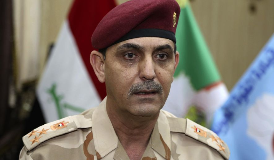 """Brig. Yahya Rasool Abdullah, an Iraqi joint command spokesman, speaks during an interview with The Associated Press in Baghdad, Iraq, Tuesday, March 28, 2017. """"It is a new tactic being used by the members of this terrorist group, using big car bombs against the troops that impact the civilians to inflame the public and to convey a wrong message to the world that the joint forces and the international coalition are behind the killing and bombings,"""" he told The Associated Press. (AP Photo/Karim Kadim)"""