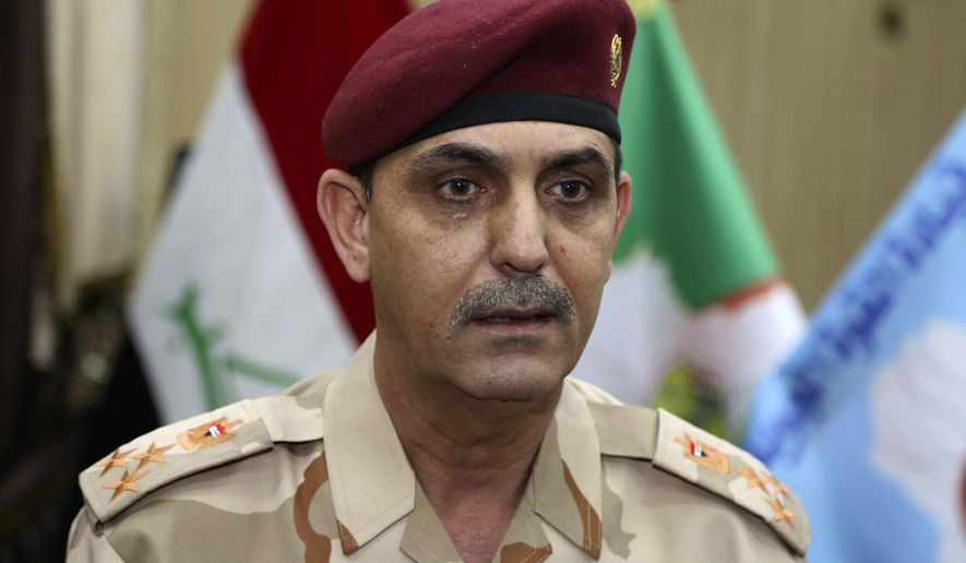 Brig. Gen. Yahya Rasool Abdullah, an Iraqi joint command spokesman, speaks during an interview with The Associated Press in Baghdad, Iraq, Tuesday, March 28, 2017. (AP Photo/Karim Kadim) ** FILE **