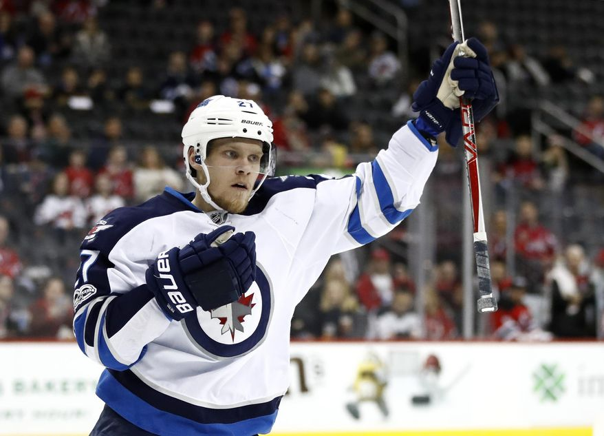 Winnipeg Jets left wing Nikolaj Ehlers, of Denmark, celebrates after scoring a goal on the New Jersey Devils during the first period of an NHL game, Tuesday, March 28, 2017, in Newark, N.J. (AP Photo/Julio Cortez)