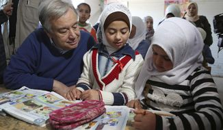 U.N. Secretary General Antonio Guterres talks to Syrian refugees in a 4th grade classroom at the U.N.-run Zaatari camp for Syrian refugees, in northern Jordan, Tuesday, March 28, 2017. Guterres appealed to Arab states to overcome their divisions on Syria and help end the country's six-year-old civil war. The U.N. chief is to attend an annual Arab Summit in Jordan on Wednesday. (AP Photo/Raad Adayleh)