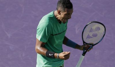 Nick Kyrgios, of Australia, reacts after winning a point against Ivo Karlovic during the Miami Open tennis tournament, Monday, March 27, 2017, in Key Biscayne, Fla. (AP Photo/Lynne Sladky)