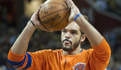 FILE - In this Oct. 25, 2016, file photo, New York Knicks' Joakim Noah warms up before an NBA basketball game against the Cleveland Cavaliers in Cleveland. Noah is expected to return to practice following knee surgery, and the Knicks hope he can begin serving his 20-game suspension for violating the NBA's anti-drug policy as soon as this week. (AP Photo/Phil Long, File)