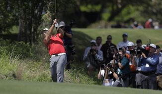 Jon Rahm, of Spain, hits from the rough on the third hole during the final round of play at the Dell Technologies Match Play golf tournament at Austin County Club, Sunday, March 26, 2017, in Austin, Texas. (AP Photo/Eric Gay)