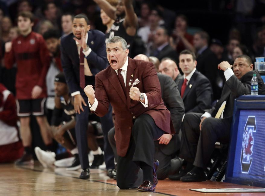 FILE - In this Sunday, March 26, 2017, file photo, South Carolina head coach Frank Martin reacts during the second half of the East Regional championship game against Florida at the NCAA men's college basketball tournament in New York. Martin may be embracing South Carolina's first Final Four run even more than this players. The hard-bitten coach has endured many changes in his his five years to get to college basketball's biggest stage. (AP Photo/Frank Franklin II)
