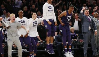 The TCU bench reacts against Central Florida during the second half of an NCAA college basketball game in the semifinals of the NIT Tuesday, March 28, 2017, in New York. (AP Photo/Kathy Willens)