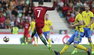 Portugal's Cristiano Ronaldo scores the opening goal during the international friendly soccer match between Portugal and Sweden at the dos Barreiros stadium in Funchal, Madeira island, Portugal, Tuesday, March 28 2017. (AP Photo/Armando Franca)