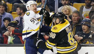 Boston Bruins' Kevan Miller (86) checks Nashville Predators' Cody McLeod (55) during the first period of an NHL hockey game in Boston, Tuesday, March 28, 2017. (AP Photo/Michael Dwyer)