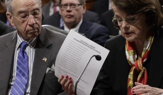 Senate Judiciary Committee Chairman Sen. Charles Grassley, R-Iowa, center, listens as the committee's ranking member, Sen. Dianne Feinstein, D-Calif. requests a one week postponement for the panel to vote on Supreme Court nominee Neil Gorsuch, as she displays a list of appointments made during presidential election years, Monday, March 27, 2017, on Capitol Hill in Washington. (AP Photo/J. Scott Applewhite)