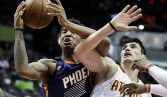 Phoenix Suns' Marquese Chriss, left, grabs a rebound from Atlanta Hawks' Ersan Ilyasova, of Turkey, in the second quarter of an NBA basketball game in Atlanta, Tuesday, March 28, 2017. (AP Photo/David Goldman)