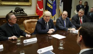 President Donald Trump speaks during a meeting with the Fraternal Order of Police, Tuesday, March 28, 2017, in the Roosevelt Room of the White House in Washington. From left are, Jim Pasco, Senior Advisor to the National FOP President, Trump, National Fraternal Order of Police President Chuck Canterbury, and Jason McDonald, National Vice President FOP. (AP Photo/Evan Vucci)
